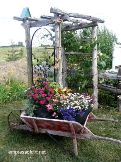 Wheel barrow planter and wooden arbor!