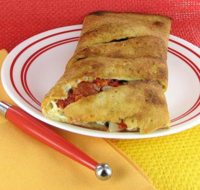 Pepperoni and cheese calzone with veggies