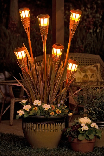 Tiki torch planters add a lot of atmosphere to a night time party.