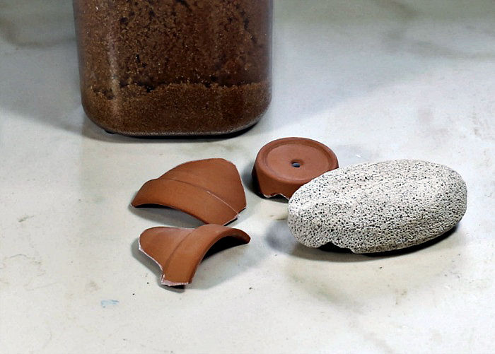 pieces of terra cotta and a pumice stone