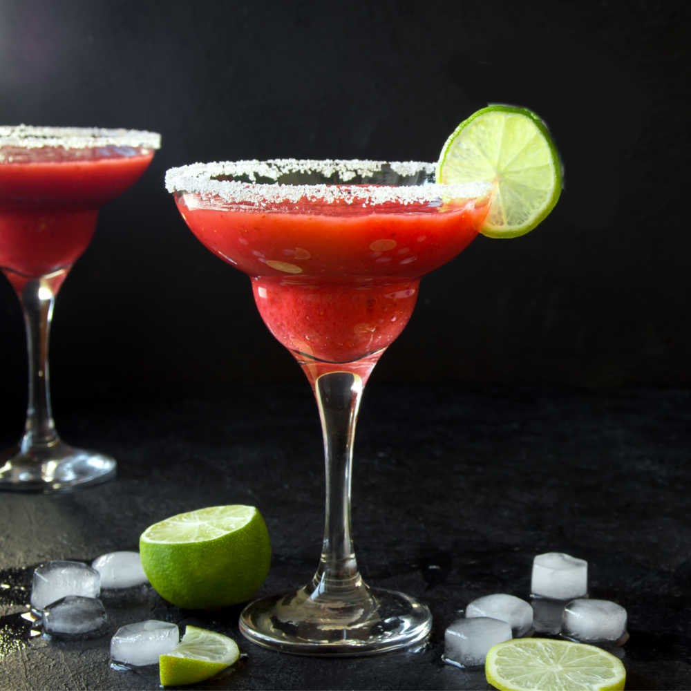 Frozen strawberry daiquiri with ice and lime.