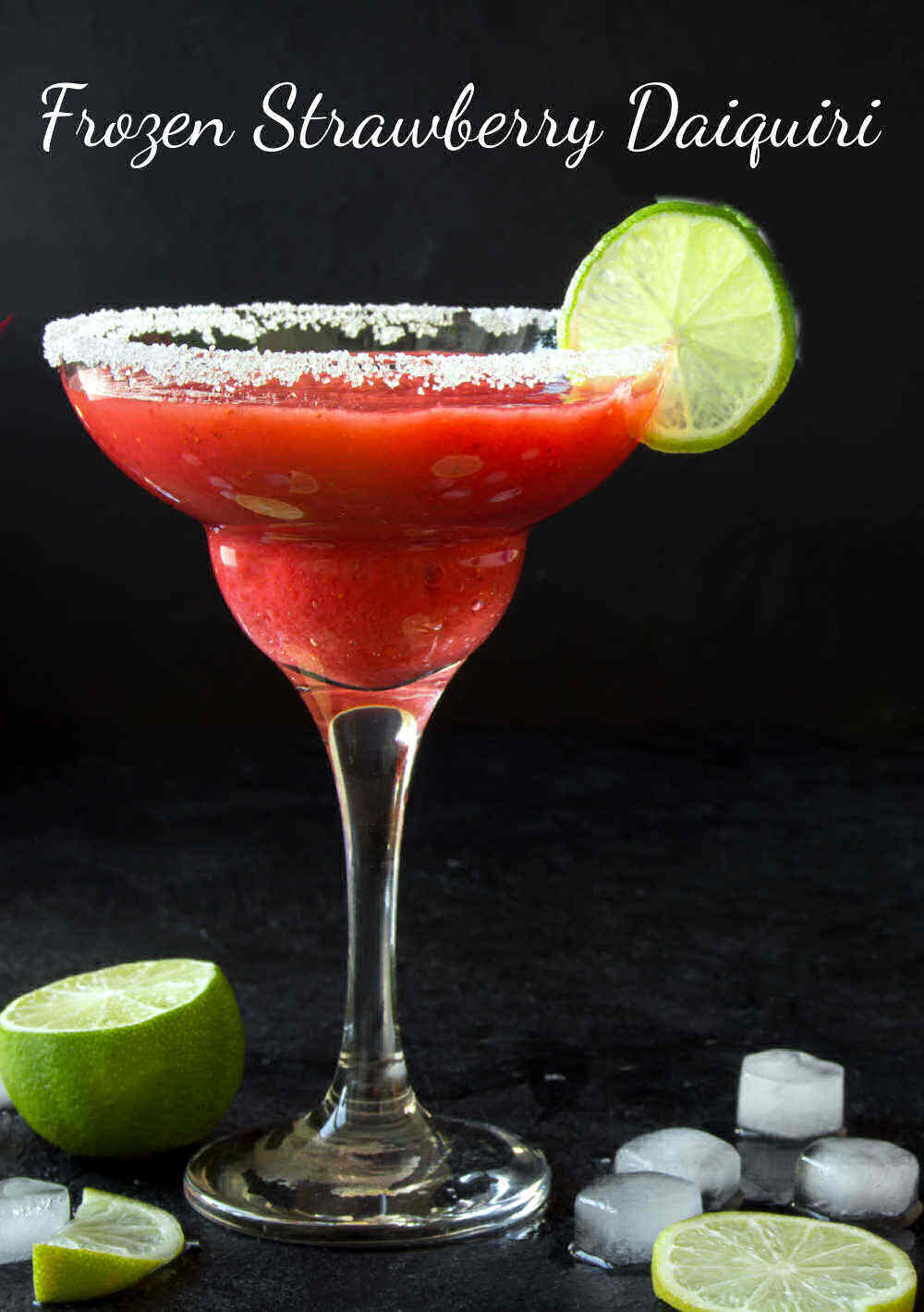 Red cocktail with lime and words Frozen strawberry daiquiri.