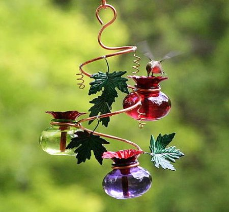 Glass and Copper Humminggbird feeder with leaves