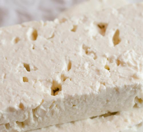 mash feta cheese with a potato masher