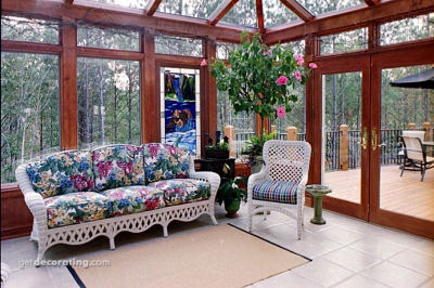 Floral sofa in a big sunroom