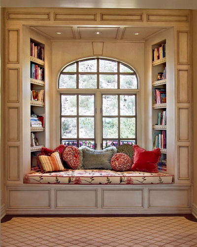 Window seat with tall library shelving