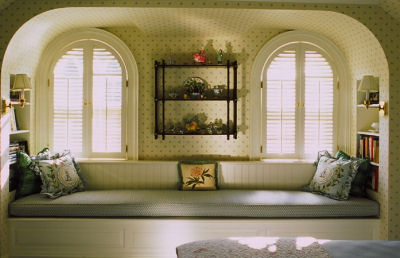 Elongated window seat with nooks and neat windows