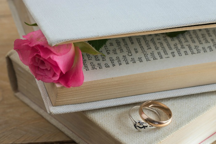 pressing roses in a book.