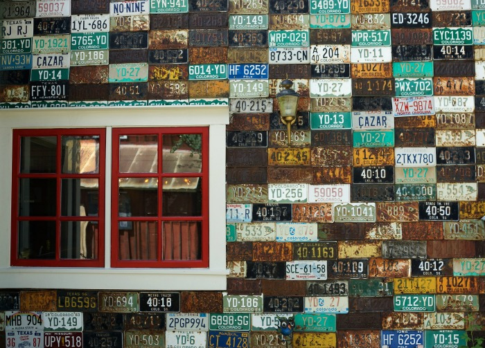 Using license plates to cover the wall of a shed