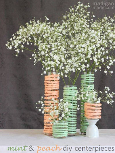 Combine raffia, hot glue and some bud vases and you get these lovely decorations