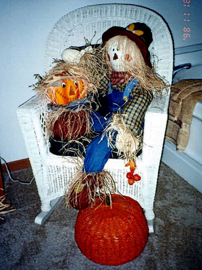Pumpkin in a chair. Fabulous fall decor!