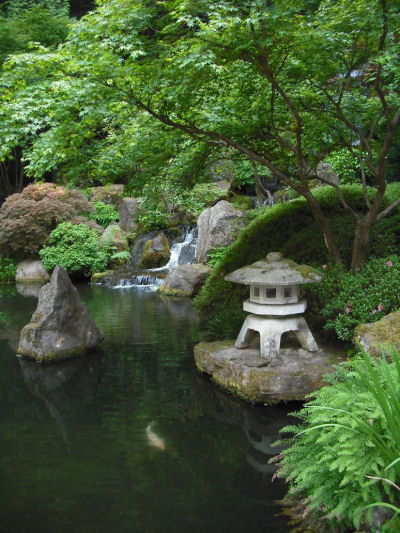 Water garden with island Meditation statue