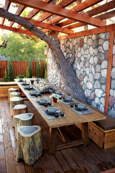 Rustic patio with tree trunk seats