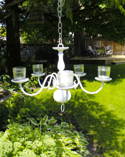 Outdoor chandelier with mason jar lighting.