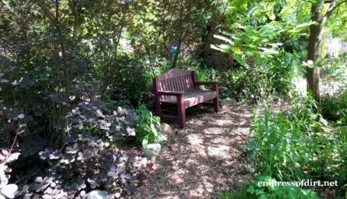 Seating area in a shady walkway.