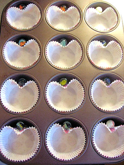 Add a marble at the top of your cupcake liners to make heart shaped cupcakes.