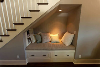 Cozy nook in unused space under the stairs.