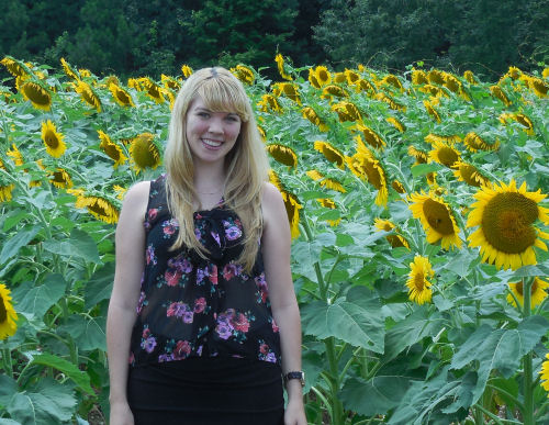 Jess in a field of Sunflowers