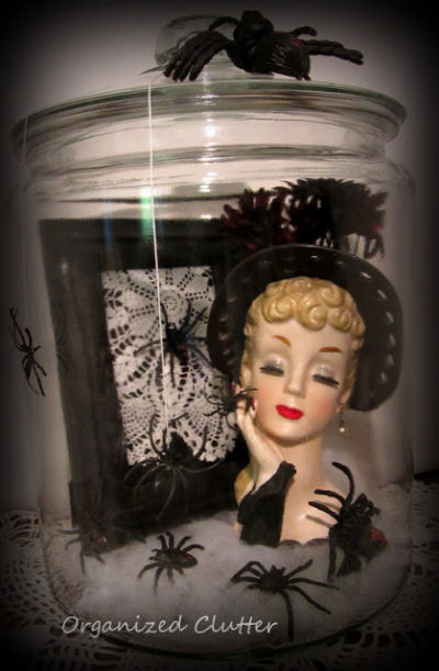 Dress up a vintage lady head vase with spiders for Halloween
