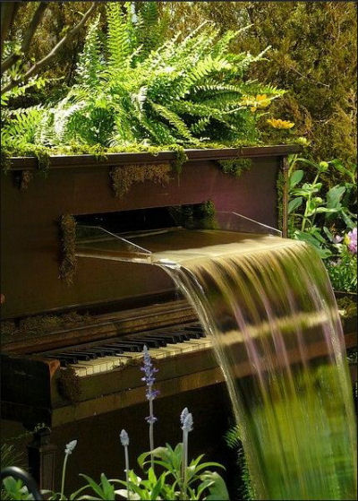 Player piano turned into a garden water feature