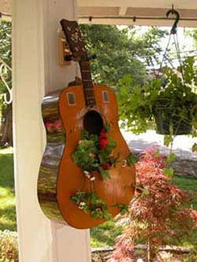 Guitar used as a container for plants