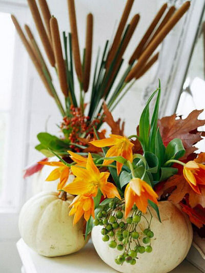 White Faux pumpkin used as a vase for cat's tails and fall greenery and flowers