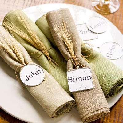 Napkin rings and place holders in one. So rustic with the wheat!