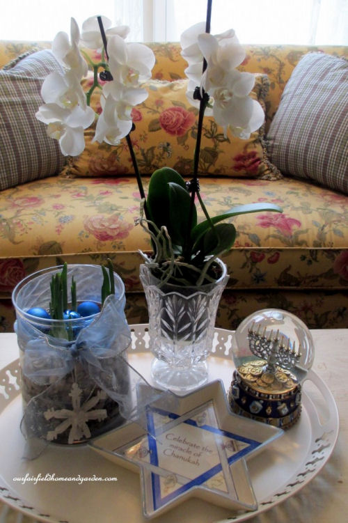 Table decor with Channukah decorations and paperwhites from ourfairfieldhomeandgarden.com