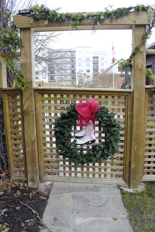 decorative wreath, ice skates and a garland from newhousenewhomenewlife.com