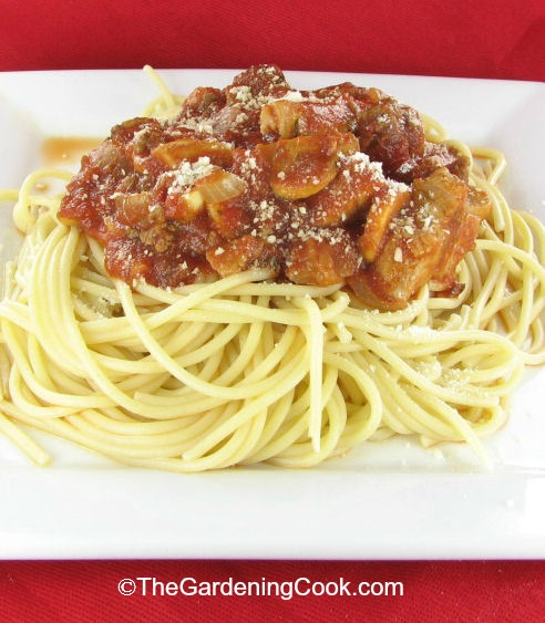 Homemade spaghetti bolognese sauce with pork chops