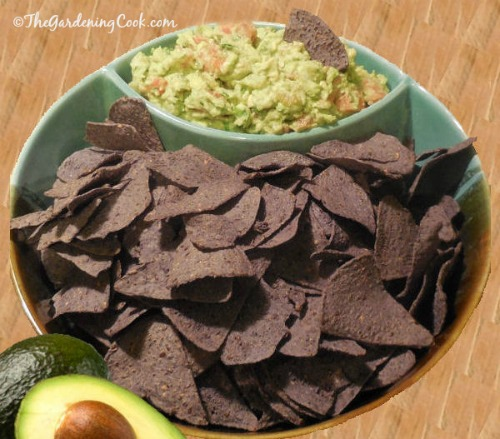 Best Ever Guacamole with dark tortilla chips