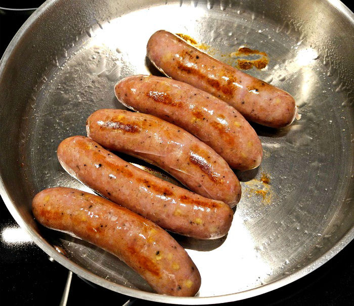 Browining sausages in a saute pan.