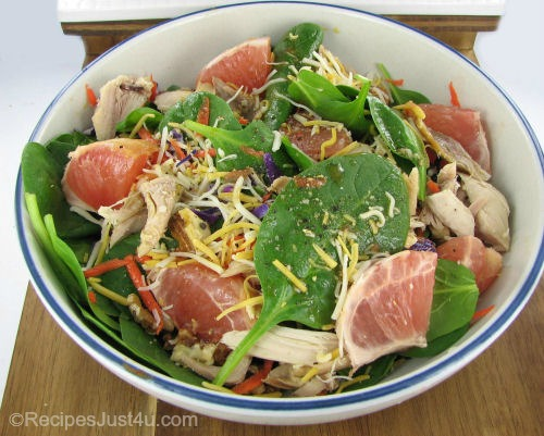 Citrus salad with chicken, walnuts and grapefruit