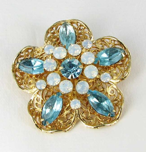 Blue translucent glass brooch