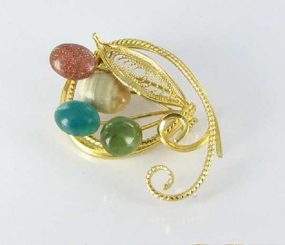 Gemstone flower brooch
