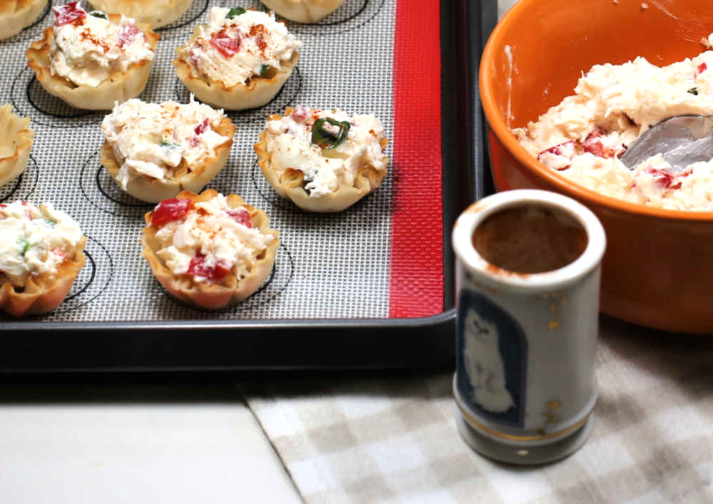 Phyllo cup crab appetizers garnished with paprika.