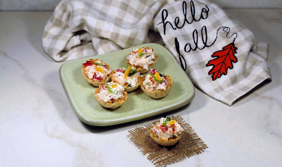 Phyllo cup recipe with crab and a tea towel that says Hello Fall.