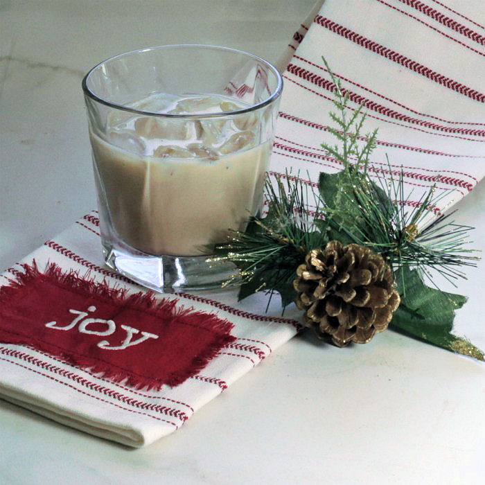 Bailey's Mudslide cocktail over ice with pine cone and joy towel.
