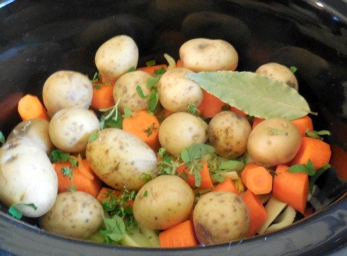 slow cooker pot roast vegetables seasoned with fresh herbs