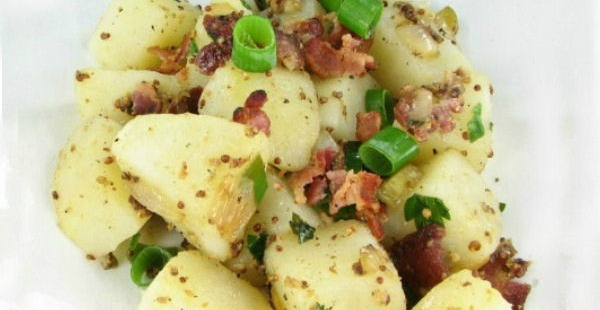 Traditional German potato salad recipe with bacon and pickles
