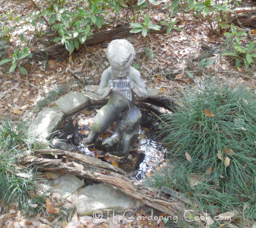 Pan statue in a water feature