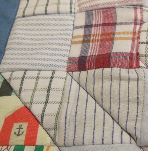 Old shirts form squares of the memory square