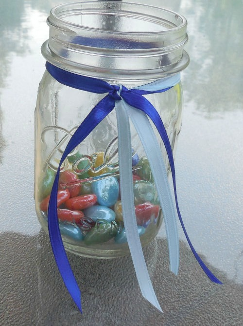2 colors of ribbon add a decorative touch to the mason jars