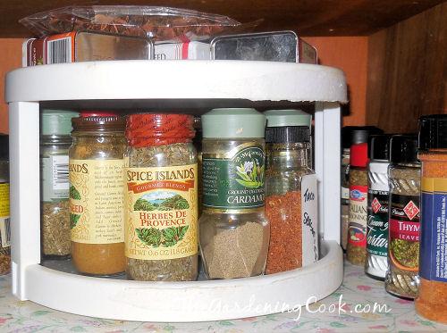 Lazy Susan keep spice jars handy.