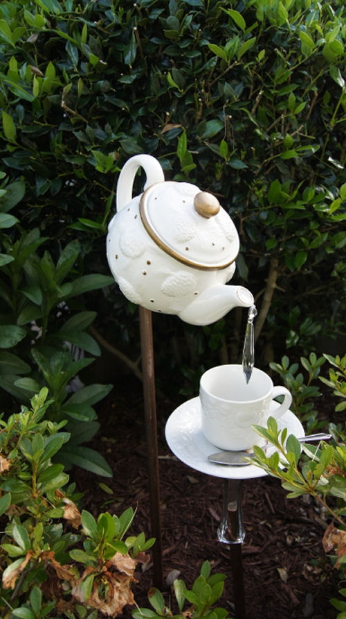 Cute tea pot garden art.