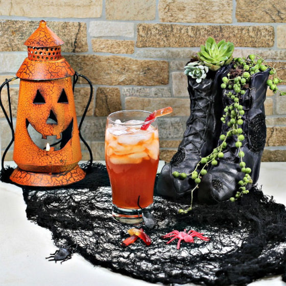 Witches brew Halloween cocktail and spooky props