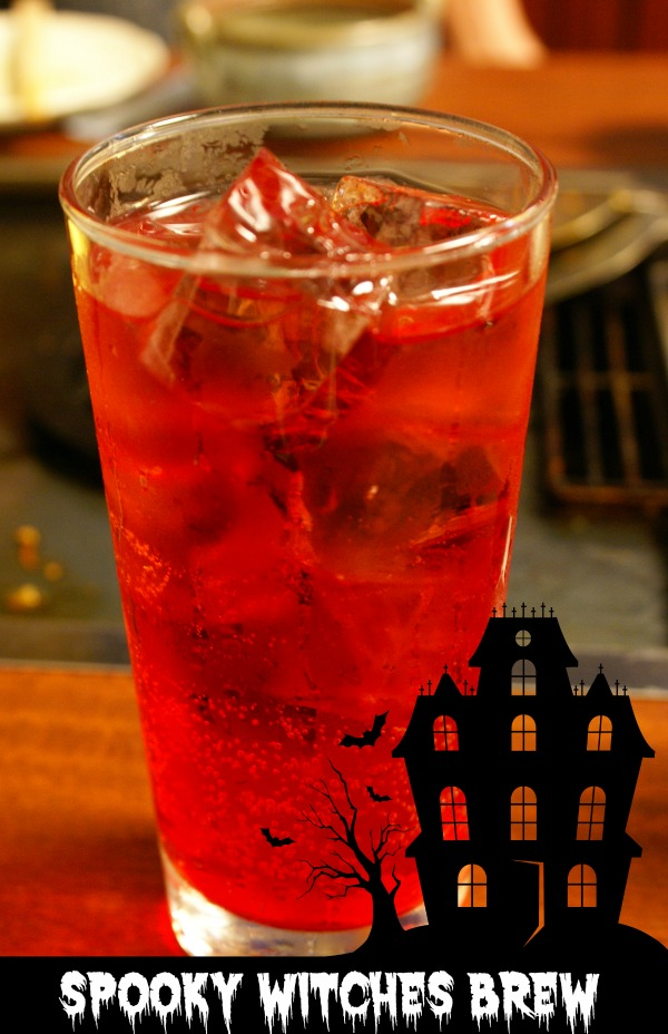 Orange witches brew uses cranberry and pineapple juice as well as Sprite and coconut rum for a fun Halloween drink.