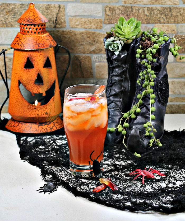 Witches brew cocktail, witch shoe planter and pumpkin lantern