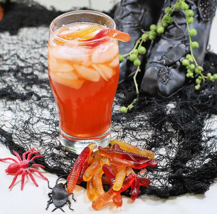 Witches brew cocktail and gummy worms