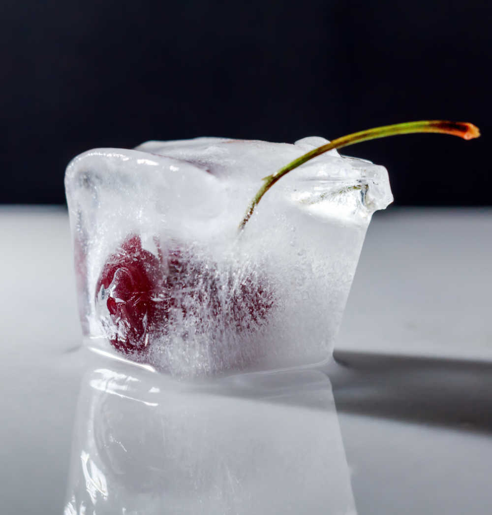 Cherry frozen in a large ice cube